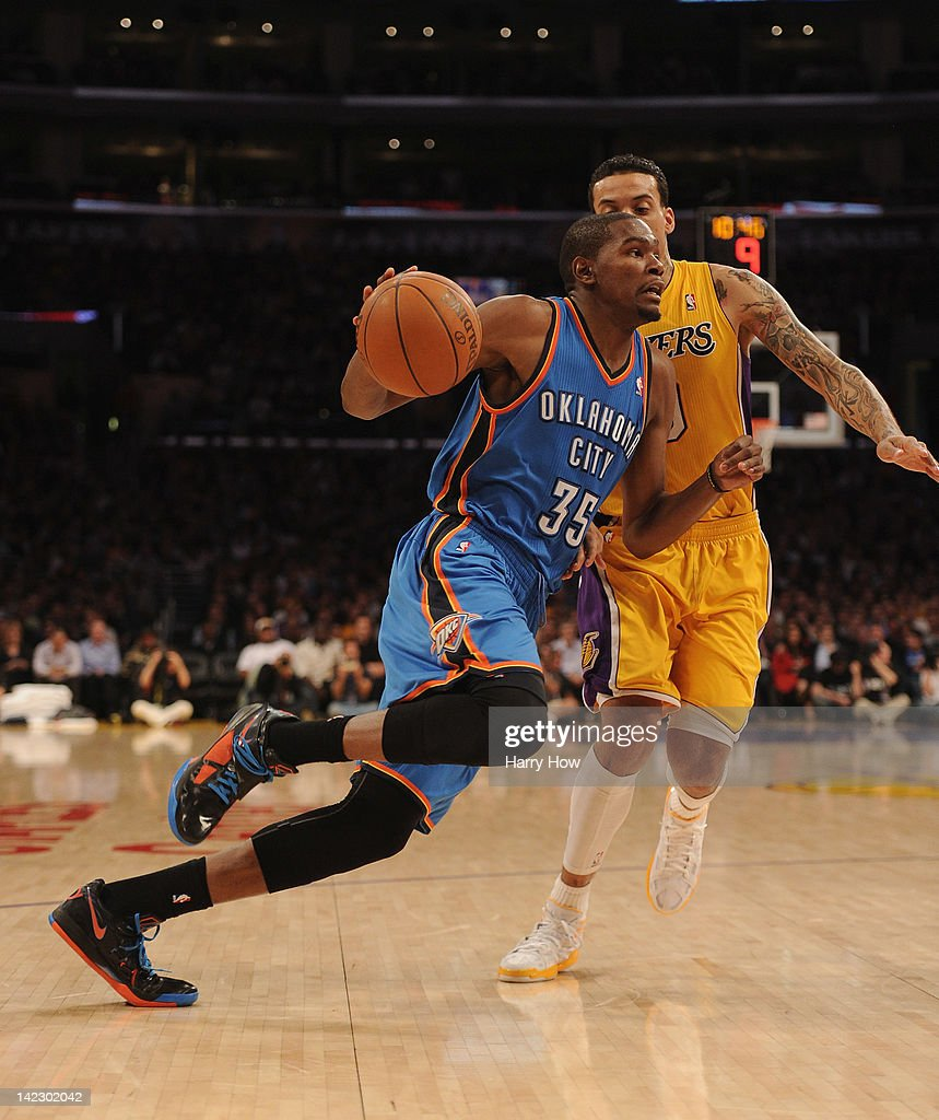 <a gi-track='captionPersonalityLinkClicked' href=/galleries/search?phrase=Kevin+Durant&family=editorial&specificpeople=3847329 ng-click='$event.stopPropagation()'>Kevin Durant</a> #35 of the Oklahoma City Thunder dribbles by <a gi-track='captionPersonalityLinkClicked' href=/galleries/search?phrase=Matt+Barnes+-+Basketball+Player&family=editorial&specificpeople=202880 ng-click='$event.stopPropagation()'>Matt Barnes</a> #9 of the Los Angeles Lakers during a 102-93 Thunder win at Staples Center on March 29, 2012 in Los Angeles, California.