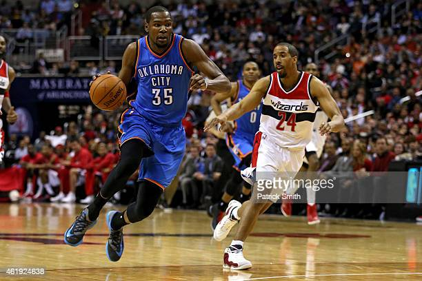 Kevin Durant of the Oklahoma City Thunder dribbles past Andre Miller of the Washington Wizards in the first half at Verizon Center on January 21 2015...