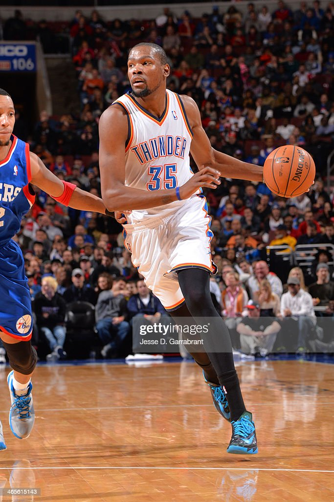 <a gi-track='captionPersonalityLinkClicked' href=/galleries/search?phrase=Kevin+Durant&family=editorial&specificpeople=3847329 ng-click='$event.stopPropagation()'>Kevin Durant</a> #35 of the Oklahoma City Thunder dribbles the ball against the Philadelphia 76ers at the Wells Fargo Center on January 25, 2014 in Philadelphia, Pennsylvania.