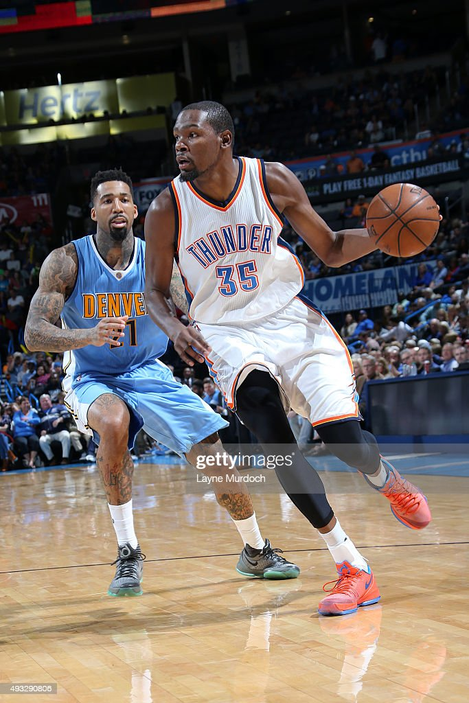 Kevin Durant of the Oklahoma City Thunder dribbles the ball against Wilson Chandler of the Denver Nuggets during a preseason game on October 18 2015...