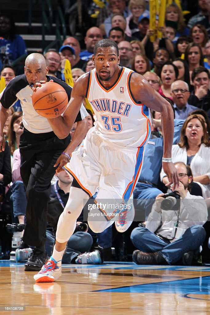 Kevin Durant #35 of the Oklahoma City Thunder dribbles the ball up the court against the Denver Nuggets during an NBA game on March 19, 2013 at the Chesapeake Energy Arena in Oklahoma City, Oklahoma.