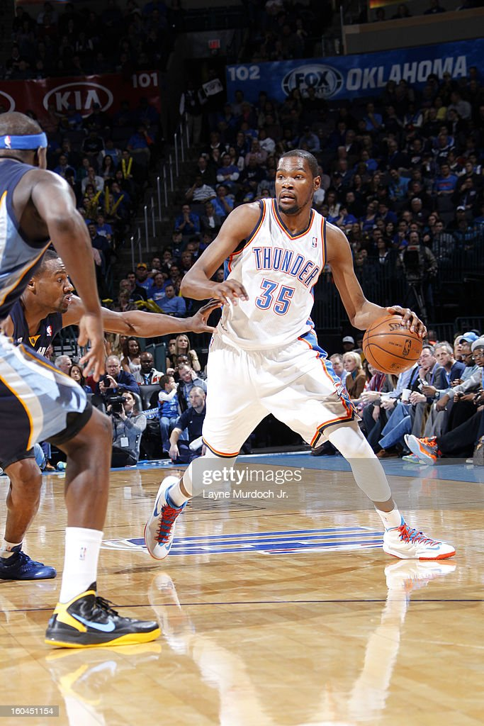 Kevin Durant #35 of the Oklahoma City Thunder dribbles the ball while looking to pass against the Memphis Grizzlies during an NBA game on January 31, 2013 at the Chesapeake Energy Arena in Oklahoma City, Oklahoma.