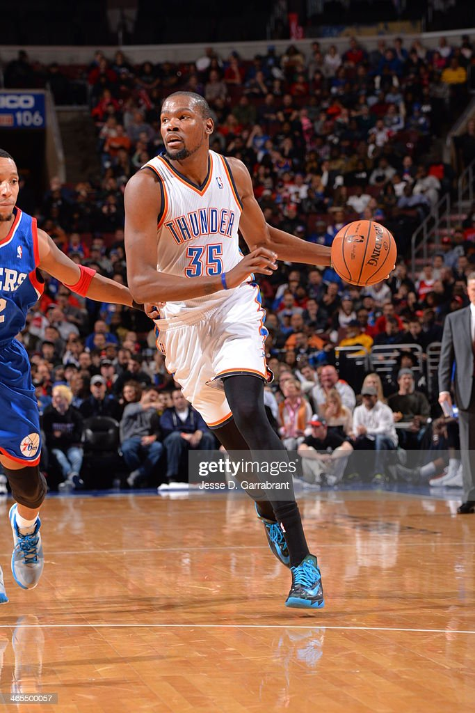<a gi-track='captionPersonalityLinkClicked' href=/galleries/search?phrase=Kevin+Durant&family=editorial&specificpeople=3847329 ng-click='$event.stopPropagation()'>Kevin Durant</a> #35 of the Oklahoma City Thunder dribbles to the basket against the Philadelphia 76ers at the Wells Fargo Center on January 25, 2014 in Philadelphia, Pennsylvania.
