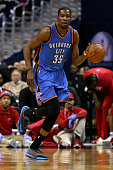 Kevin Durant of the Oklahoma City Thunder dribbles up court against the Washington Wizards in the first half at Verizon Center on January 21 2015 in...