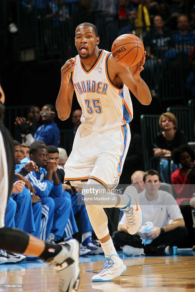 <a gi-track='captionPersonalityLinkClicked' href=/galleries/search?phrase=Kevin+Durant&family=editorial&specificpeople=3847329 ng-click='$event.stopPropagation()'>Kevin Durant</a> #35 of the Oklahoma City Thunder dribbles up the court against the San Antonio Spurs during an NBA game on December 17, 2012 at the Chesapeake Energy Arena in Oklahoma City, Oklahoma.
