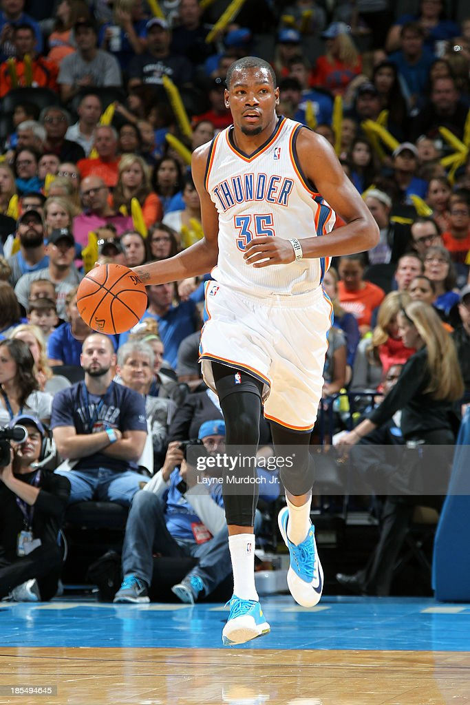 <a gi-track='captionPersonalityLinkClicked' href=/galleries/search?phrase=Kevin+Durant&family=editorial&specificpeople=3847329 ng-click='$event.stopPropagation()'>Kevin Durant</a> #35 of the Oklahoma City Thunder dribbles up the floor against the Utah Jazz during an NBA preseason game on October 20, 2013 at the Chesapeake Energy Arena in Oklahoma City, Oklahoma.