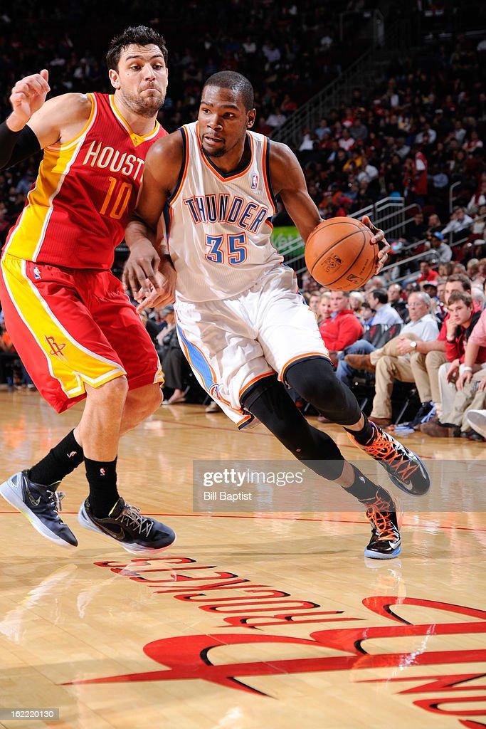 Kevin Durant #35 of the Oklahoma City Thunder drives against Carlos Delfino #10 of the Houston Rockets on February 20, 2013 at the Toyota Center in Houston, Texas.