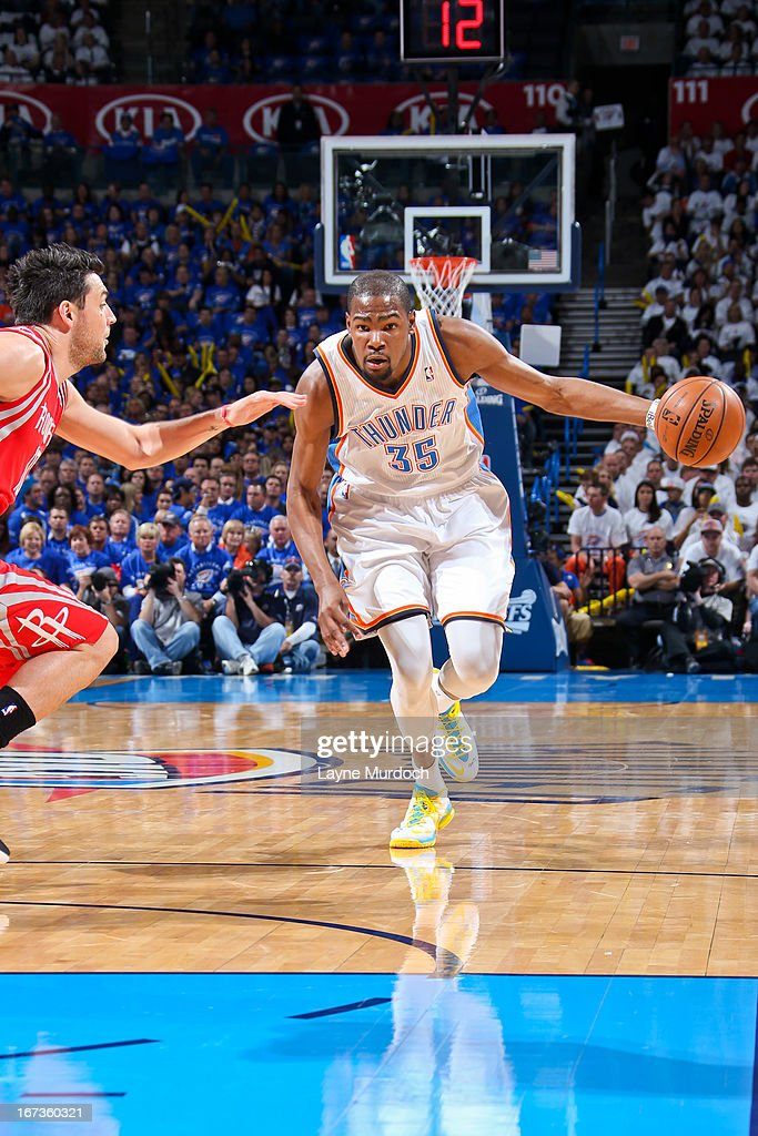 Kevin Durant #35 of the Oklahoma City Thunder drives against Carlos Delfino #10 of the Houston Rockets in Game Two of the Western Conference Quarterfinals during the 2013 NBA Playoffs on April 24, 2013 at the Chesapeake Energy Arena in Oklahoma City, Oklahoma.