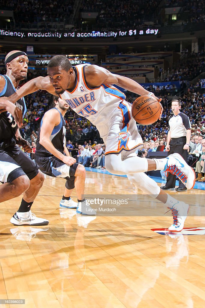 Kevin Durant #35 of the Oklahoma City Thunder drives against Dante Cunningham #33 of the Minnesota Timberwolves on February 22, 2013 at the Chesapeake Energy Arena in Oklahoma City, Oklahoma.
