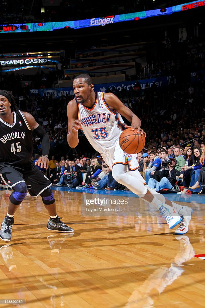 Kevin Durant #35 of the Oklahoma City Thunder drives against Gerald Wallace #45 of the Brooklyn Nets on January 2, 2013 at the Chesapeake Energy Arena in Oklahoma City, Oklahoma.