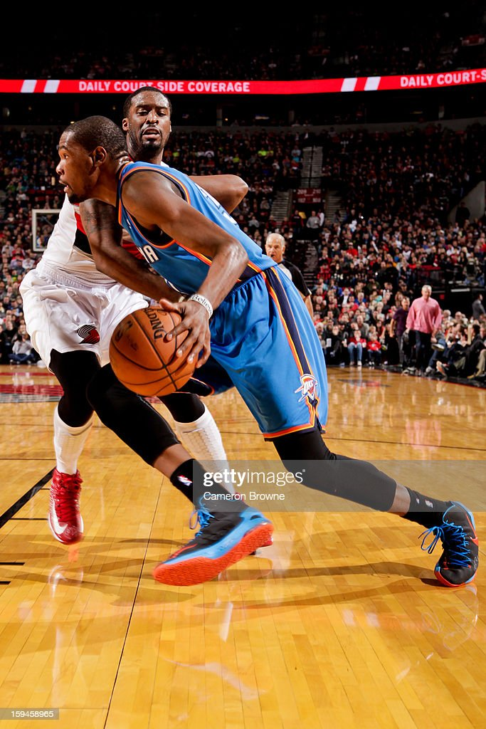Kevin Durant #35 of the Oklahoma City Thunder drives against J.J. Hickson #21 of the Portland Trail Blazers on January 13, 2013 at the Rose Garden Arena in Portland, Oregon.