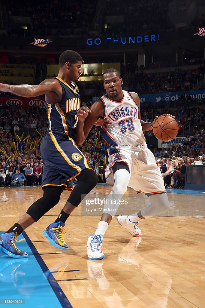 <a gi-track='captionPersonalityLinkClicked' href=/galleries/search?phrase=Kevin+Durant&family=editorial&specificpeople=3847329 ng-click='$event.stopPropagation()'>Kevin Durant</a> #35 of the Oklahoma City Thunder drives against Paul George #24 of the Indiana Pacers during the game between the Oklahoma City Thunder and the Indiana Pacers on December 9, 2012 at the Chesapeake Energy Arena in Oklahoma City, Oklahoma.