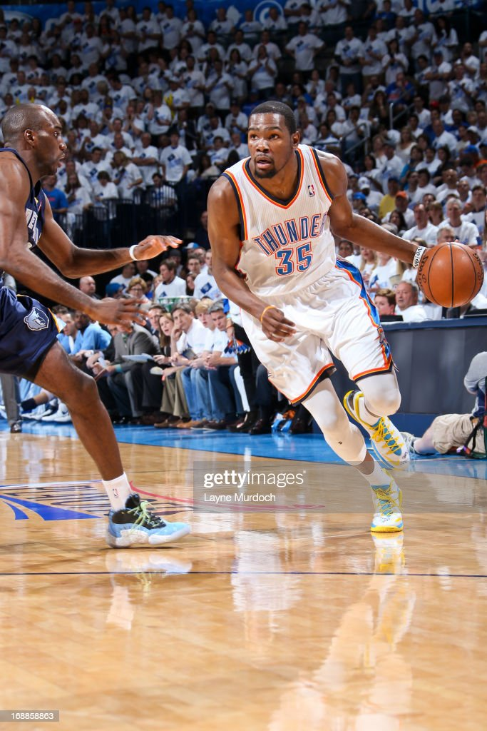 Kevin Durant #35 of the Oklahoma City Thunder drives against Quincy Pondexter #20 of the Memphis Grizzlies in Game Five of the Western Conference Semifinals during the 2013 NBA Playoffs on May 15, 2013 at the Chesapeake Energy Arena in Oklahoma City, Oklahoma.