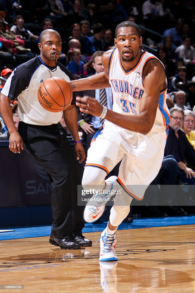 <a gi-track='captionPersonalityLinkClicked' href=/galleries/search?phrase=Kevin+Durant&family=editorial&specificpeople=3847329 ng-click='$event.stopPropagation()'>Kevin Durant</a> #35 of the Oklahoma City Thunder drives against the Brooklyn Nets on January 2, 2013 at the Chesapeake Energy Arena in Oklahoma City, Oklahoma.