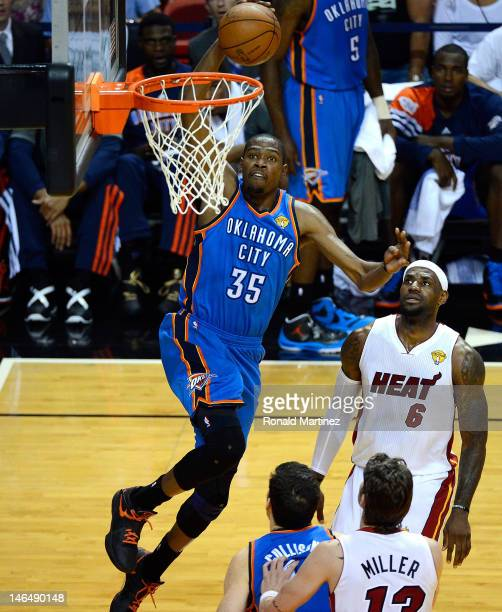 Kevin Durant of the Oklahoma City Thunder drives for a dunk attempt in the first half against LeBron James of the Miami Heat in Game Three of the...