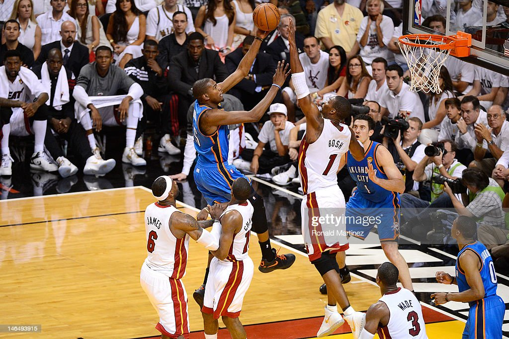 Kevin Durant #35 of the Oklahoma City Thunder drives for a shot attempt against Chris Bosh #1 of the Miami Heat in Game Three of the 2012 NBA Finals on June 17, 2012 at American Airlines Arena in Miami, Florida.
