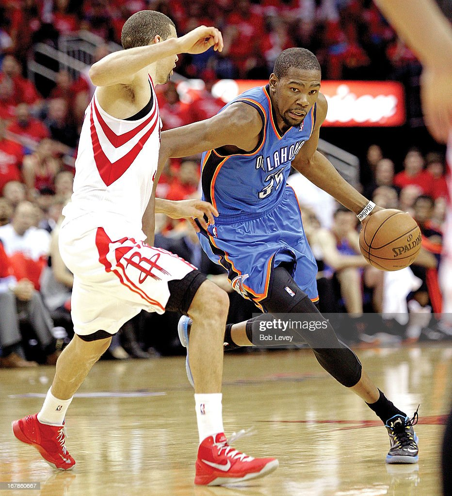 <a gi-track='captionPersonalityLinkClicked' href=/galleries/search?phrase=Kevin+Durant&family=editorial&specificpeople=3847329 ng-click='$event.stopPropagation()'>Kevin Durant</a> #35 of the Oklahoma City Thunder drives on Francisco Garcia #32 of the Houston Rockets during Game Four of the Western Conference Quarterfinals of the 2013 NBA Playoffs at the Toyota Center on April 29, 2013 in Houston, Texas.