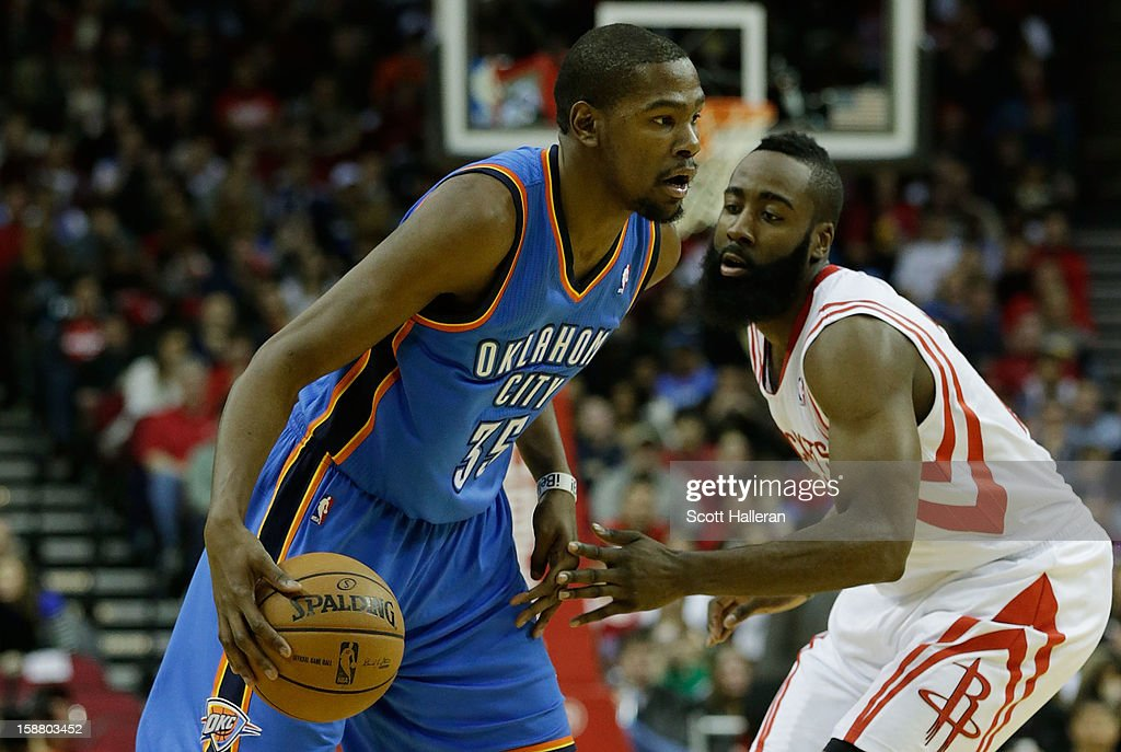 Kevin Durant #35 of the Oklahoma City Thunder drives past James Harden #13 of the Houston Rockets at the Toyota Center on December 29, 2012 in Houston, Texas.