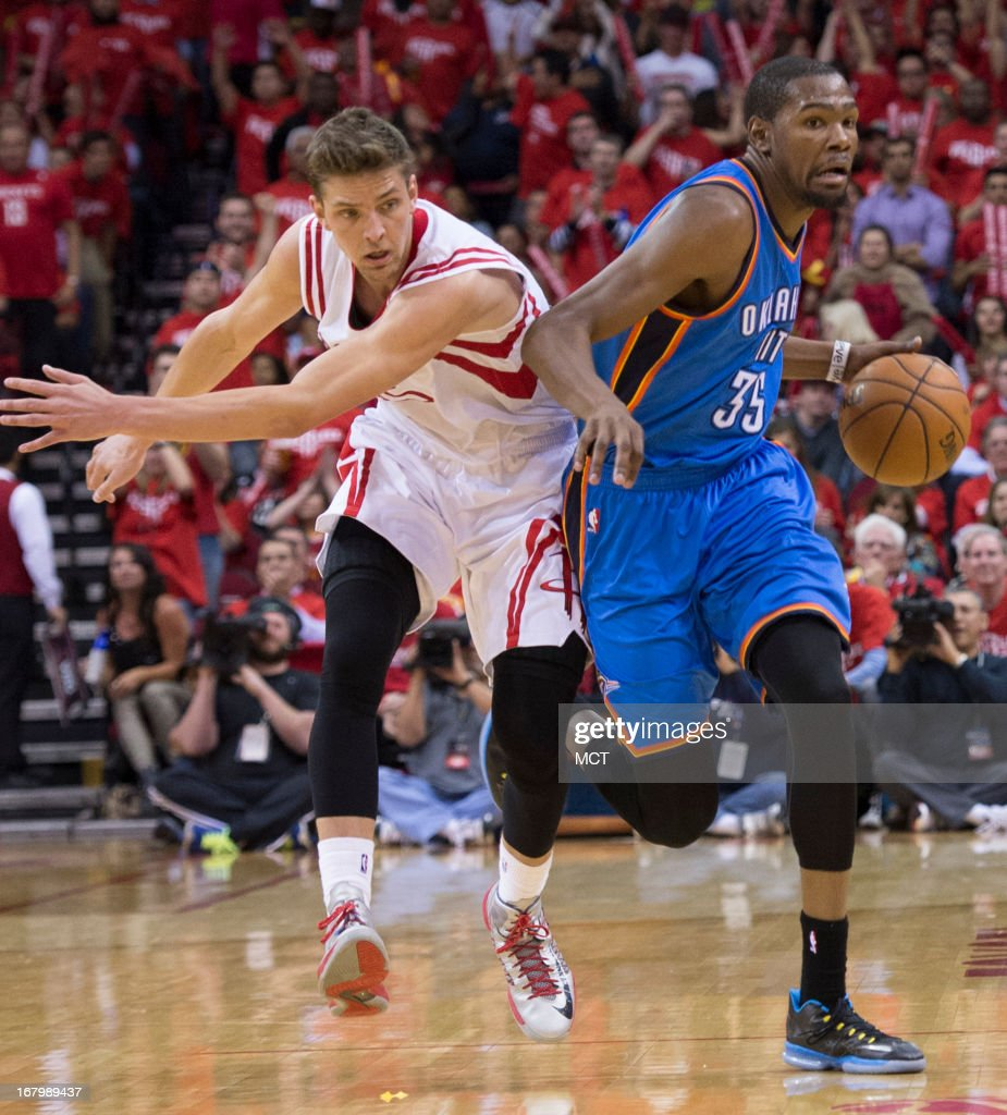 Kevin Durant (35) of the Oklahoma City Thunder drives the ball down court against Chandler Parsons (25) of the Houston Rockets in the second half of their Western Conference playoff game game on Friday, May 3, 2013, in Houston, Texas.