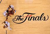 Kevin Durant of the Oklahoma City Thunder drives to the basket as teammates Kendrick Perkins and Serge Ibaka block LeBron James of the Miami Heat...