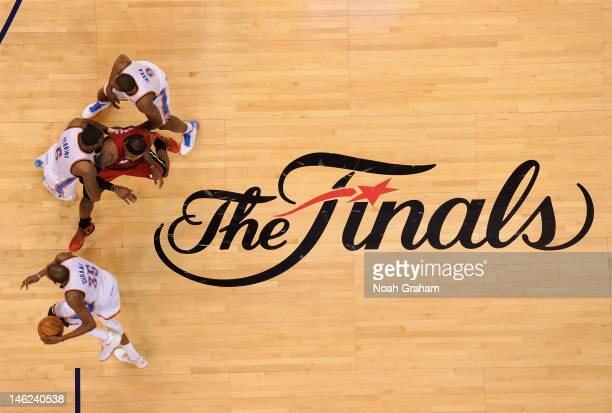Kevin Durant of the Oklahoma City Thunder drives to the basket as teammates Kendrick Perkins and Serge Ibaka block LeBron James of the Miami Heat...