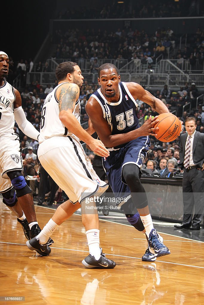 <a gi-track='captionPersonalityLinkClicked' href=/galleries/search?phrase=Kevin+Durant&family=editorial&specificpeople=3847329 ng-click='$event.stopPropagation()'>Kevin Durant</a> #35 of the Oklahoma City Thunder drives to the basket against <a gi-track='captionPersonalityLinkClicked' href=/galleries/search?phrase=Deron+Williams&family=editorial&specificpeople=203215 ng-click='$event.stopPropagation()'>Deron Williams</a> #8 of the Brooklyn Nets on December 4, 2012 at the Barclays Center in the Brooklyn Borough of New York City.