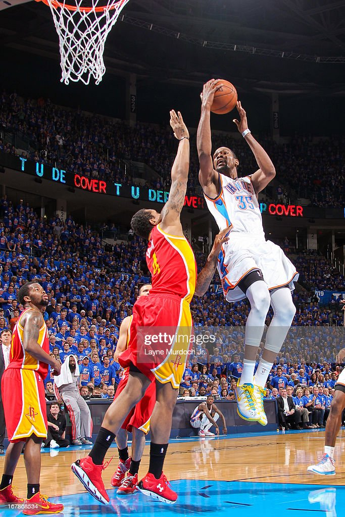 Kevin Durant #35 of the Oklahoma City Thunder drives to the basket against Greg Smith #4 of thenouston Rockets in Game Five of the Western Conference Quarterfinals during the 2013 NBA Playoffs on May 1, 2013 at the Chesapeake Energy Arena in Oklahoma City, Oklahoma.