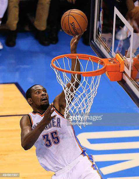 Kevin Durant of the Oklahoma City Thunder drives to the basket in the second half against the San Antonio Spurs during Game Six of the Western...