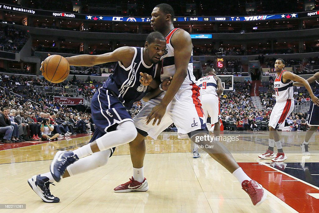 Kevin Durant #35 of the Oklahoma City Thunder drives to the basket against Kevin Seraphin #13 of the Washington Wizards during the first half at Verizon Center on January 7, 2013 in Washington, DC.