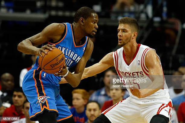 Kevin Durant of the Oklahoma City Thunder drives to the basket against Chandler Parsons of the Houston Rockets during a game at the Toyota Center on...