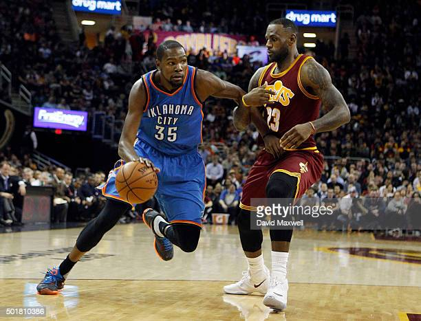 Kevin Durant of the Oklahoma City Thunder drives to the basket against LeBron James of the Cleveland Cavaliers during the first half of their game on...