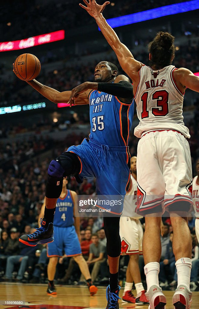 <a gi-track='captionPersonalityLinkClicked' href=/galleries/search?phrase=Kevin+Durant&family=editorial&specificpeople=3847329 ng-click='$event.stopPropagation()'>Kevin Durant</a> #35 of the Oklahoma City Thunder drives to the basket past <a gi-track='captionPersonalityLinkClicked' href=/galleries/search?phrase=Joakim+Noah&family=editorial&specificpeople=699038 ng-click='$event.stopPropagation()'>Joakim Noah</a> #13 of the Chicago Bulls at the United Center on November 8, 2012 in Chicago, Illinois.The Thunder defeated the Bulls 97-91.