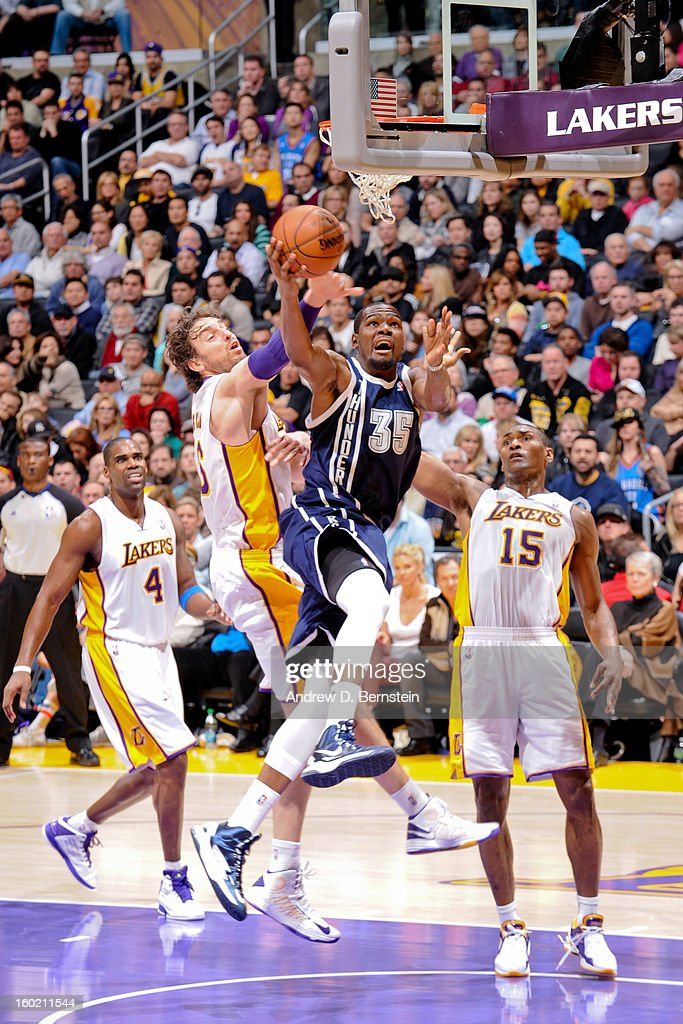 Kevin Durant #35 of the Oklahoma City Thunder drives to the basket against Pau Gasol #16 of the Los Angeles Lakers at Staples Center on January 27, 2013 in Los Angeles, California.