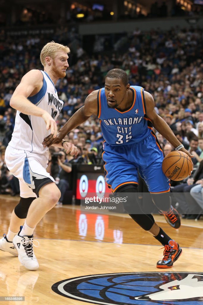 <a gi-track='captionPersonalityLinkClicked' href=/galleries/search?phrase=Kevin+Durant&family=editorial&specificpeople=3847329 ng-click='$event.stopPropagation()'>Kevin Durant</a> #35 of the Oklahoma City Thunder drives to the basket against the Minnesota Timberwolves on March 29, 2013 at Target Center in Minneapolis, Minnesota.
