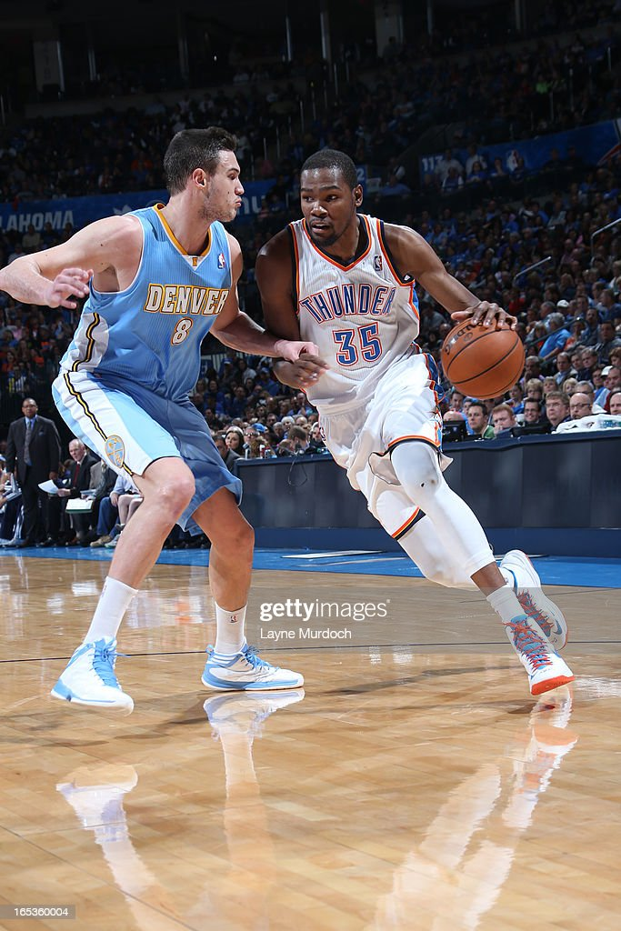 <a gi-track='captionPersonalityLinkClicked' href=/galleries/search?phrase=Kevin+Durant&family=editorial&specificpeople=3847329 ng-click='$event.stopPropagation()'>Kevin Durant</a> #35 of the Oklahoma City Thunder drives to the basket against the Denver Nuggets on March 19, 2013 at the Chesapeake Energy Arena in Oklahoma City, Oklahoma.