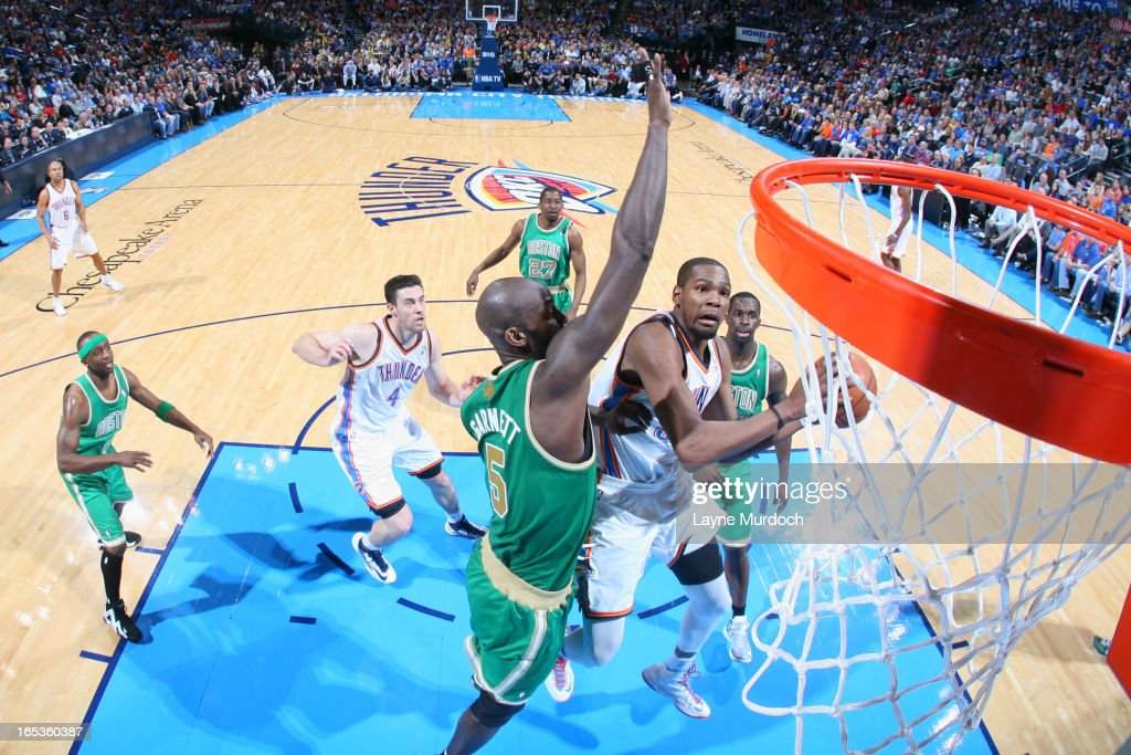 <a gi-track='captionPersonalityLinkClicked' href=/galleries/search?phrase=Kevin+Durant&family=editorial&specificpeople=3847329 ng-click='$event.stopPropagation()'>Kevin Durant</a> #35 of the Oklahoma City Thunder drives to the basket against the Boston Celtics on March 10, 2013 at the Chesapeake Energy Arena in Oklahoma City, Oklahoma.