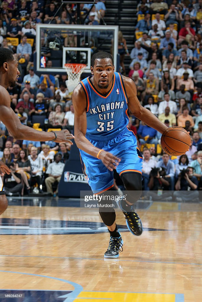 <a gi-track='captionPersonalityLinkClicked' href=/galleries/search?phrase=Kevin+Durant&family=editorial&specificpeople=3847329 ng-click='$event.stopPropagation()'>Kevin Durant</a> #35 of the Oklahoma City Thunder drives to the basket against the Memphis Grizzlies in Game Three of the Western Conference Semifinals during the 2013 NBA Playoffs on May 11, 2013 at FedExForum in Memphis, Tennessee.