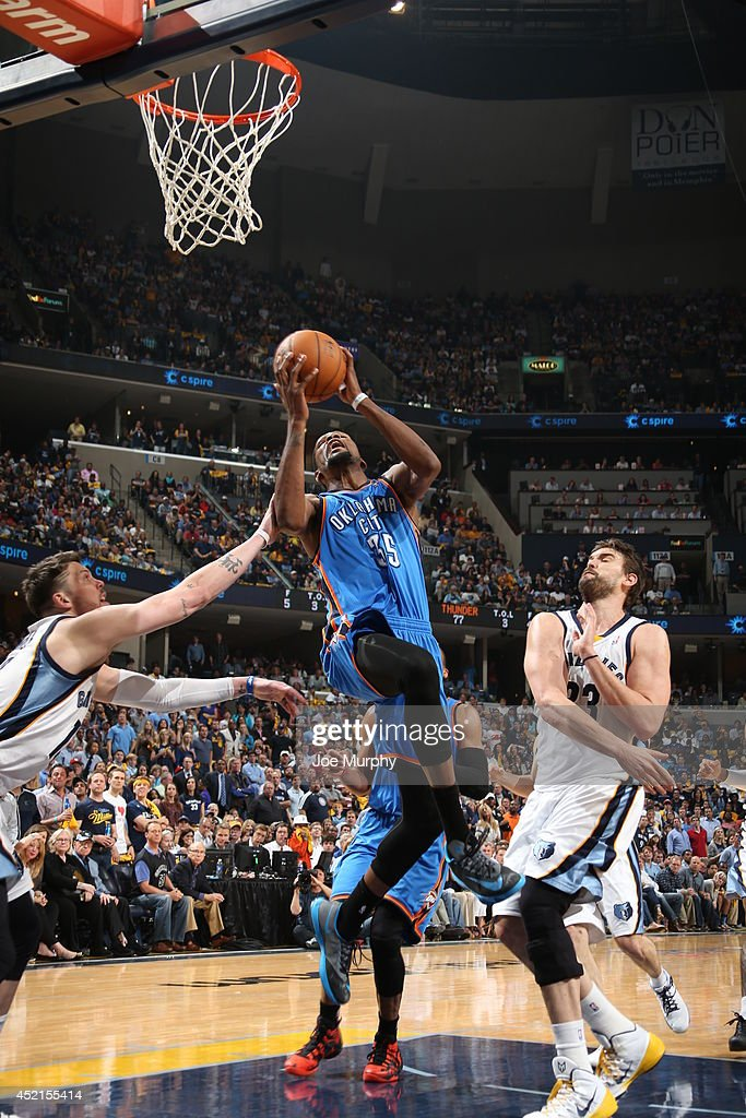<a gi-track='captionPersonalityLinkClicked' href=/galleries/search?phrase=Kevin+Durant&family=editorial&specificpeople=3847329 ng-click='$event.stopPropagation()'>Kevin Durant</a> #35 of the Oklahoma City Thunder drives to the basket against the Memphis Grizzlies in Game Six of the Western Conference Quarterfinals during the 2014 NBA Playoffs on May 3, 2014 at FedExForum in Memphis, Tennessee.