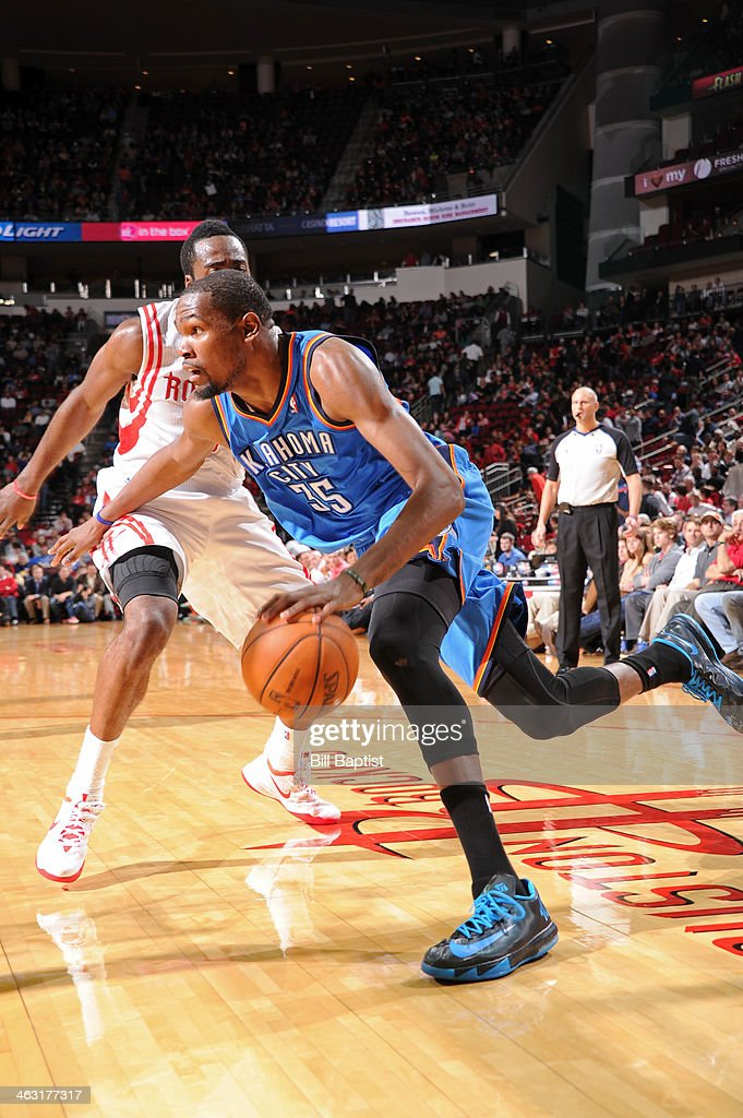 Kevin Durant #35 of the Oklahoma City Thunder drives to the basket against the Houston Rockets on January 16, 2014 at the Toyota Center in Houston, Texas.
