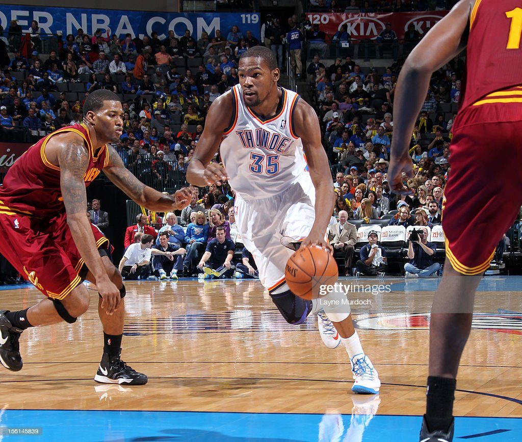 <a gi-track='captionPersonalityLinkClicked' href=/galleries/search?phrase=Kevin+Durant&family=editorial&specificpeople=3847329 ng-click='$event.stopPropagation()'>Kevin Durant</a> #35 of the Oklahoma City Thunder drives to the basket vs the Cleveland Cavaliers during an NBA game on November 11, 2012 at the Chesapeake Energy Arena in Oklahoma City, Oklahoma.
