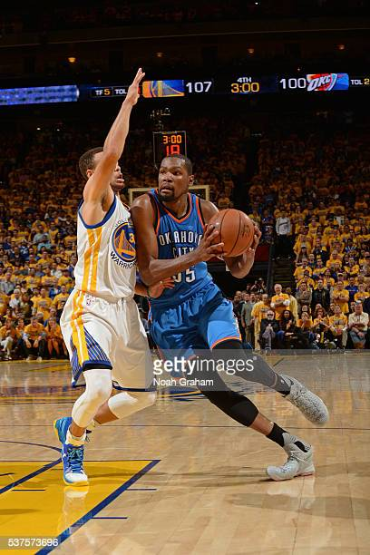 Kevin Durant of the Oklahoma City Thunder drives to the basket while guarded by Stephen Curry of the Golden State Warriors in Game Five of the...