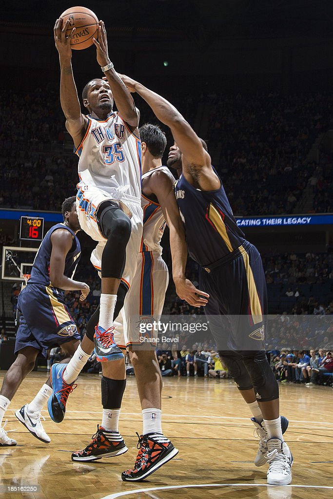 <a gi-track='captionPersonalityLinkClicked' href=/galleries/search?phrase=Kevin+Durant&family=editorial&specificpeople=3847329 ng-click='$event.stopPropagation()'>Kevin Durant</a> #35 of the Oklahoma City Thunder drives to the hoop during the NBA preseason game against the New Orleans Pelicans on October 17, 2013 at the BOK Center in Tulsa, Oklahoma.