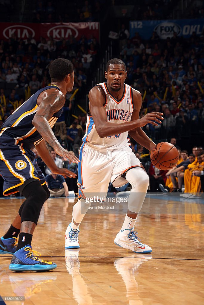<a gi-track='captionPersonalityLinkClicked' href=/galleries/search?phrase=Kevin+Durant&family=editorial&specificpeople=3847329 ng-click='$event.stopPropagation()'>Kevin Durant</a> #35 of the Oklahoma City Thunder drives under pressure during the game between the Oklahoma City Thunder and the Indiana Pacers on December 9, 2012 at the Chesapeake Energy Arena in Oklahoma City, Oklahoma.
