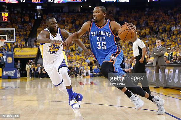 Kevin Durant of the Oklahoma City Thunder drives with the ball against Draymond Green of the Golden State Warriors during Game Five of the Western...