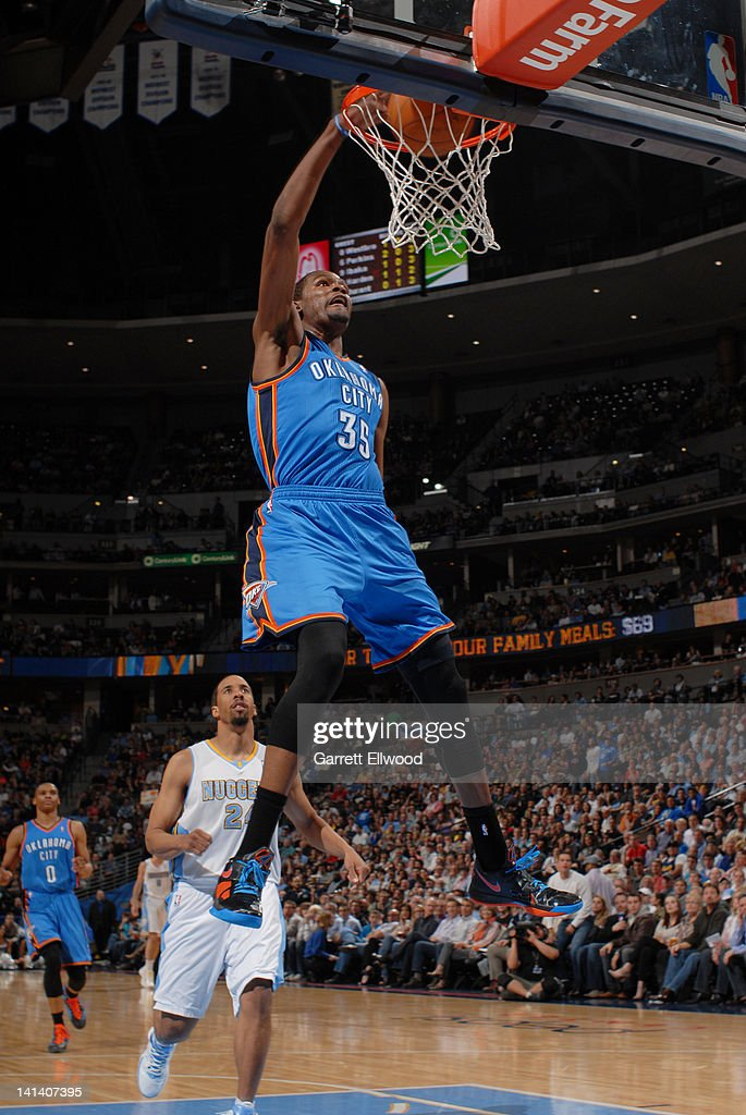 <a gi-track='captionPersonalityLinkClicked' href=/galleries/search?phrase=Kevin+Durant&family=editorial&specificpeople=3847329 ng-click='$event.stopPropagation()'>Kevin Durant</a> #35 of the Oklahoma City Thunder dunks against <a gi-track='captionPersonalityLinkClicked' href=/galleries/search?phrase=Andre+Miller&family=editorial&specificpeople=201678 ng-click='$event.stopPropagation()'>Andre Miller</a> #24 of the Denver Nuggets on March 15, 2012 at the Pepsi Center in Denver, Colorado.