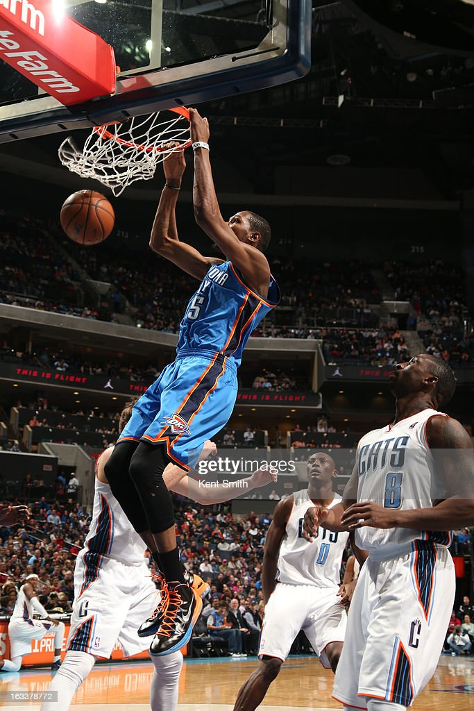 Kevin Durant #35 of the Oklahoma City Thunder dunks against Ben Gordon #8 and the Charlotte Bobcats at the Time Warner Cable Arena on March 8, 2013 in Charlotte, North Carolina.