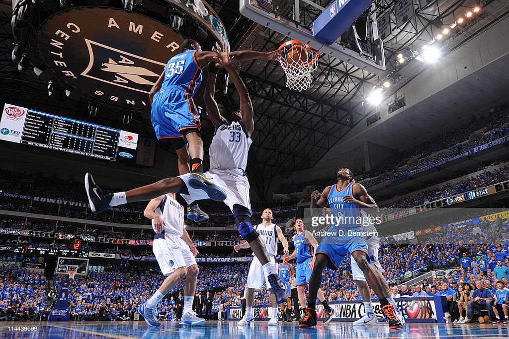 Kevin Durant #35 of the Oklahoma City Thunder dunks against Brendan Haywood #33 of the Dallas Mavericks during Game Two of the Western Conference Finals in the 2011 NBA Playoffs on May 19, 2011 at the American Airlines Center in Dallas, Texas.