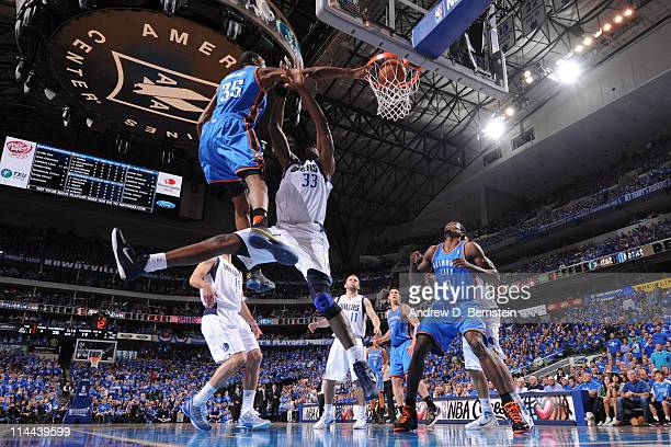 Kevin Durant of the Oklahoma City Thunder dunks against Brendan Haywood of the Dallas Mavericks during Game Two of the Western Conference Finals in...