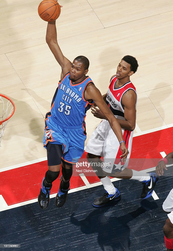 <a gi-track='captionPersonalityLinkClicked' href=/galleries/search?phrase=Kevin+Durant&family=editorial&specificpeople=3847329 ng-click='$event.stopPropagation()'>Kevin Durant</a> #35 of the Oklahoma City Thunder dunks against Nick Young #1 of the Washington Wizards during the game at the Verizon Center on January 18, 2012 in Washington, DC.