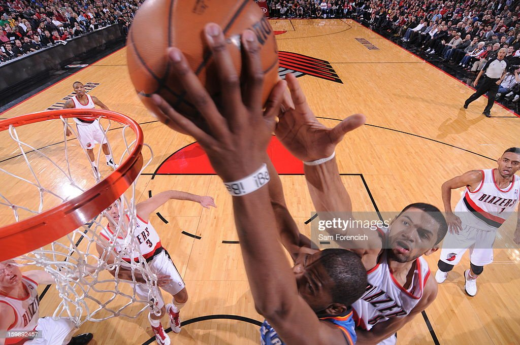 Kevin Durant #35 of the Oklahoma City Thunder dunks against Nicolas Batum #88 of the Portland Trail Blazers on January 13, 2013 at the Rose Garden Arena in Portland, Oregon.